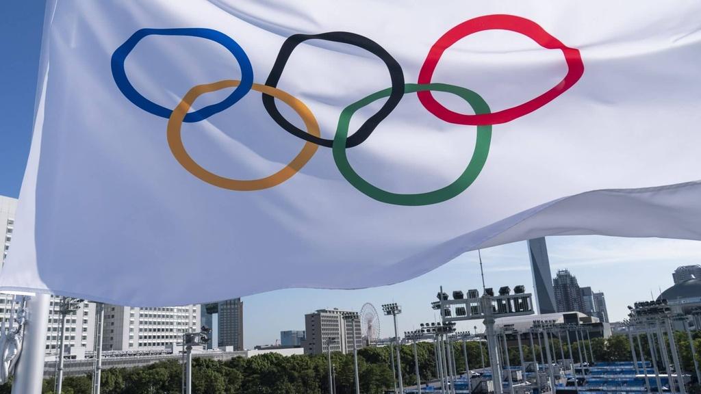 Olympijská vlajka.